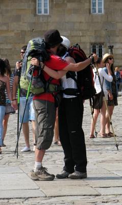 [Pilgrims hugging]
